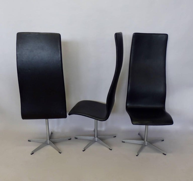 20th Century Eight Arne Jacobsen Black Leather Oxford Tall Dining Chairs For Sale