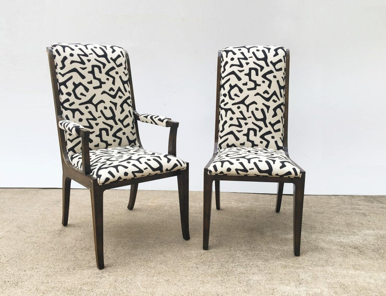 Highly sought after set designed by Bernhard Rohne for Mastercraft. The set of eight chairs, is well crafted with attention to every detail, consisting of two captain and six side chairs. Each chair in exquisitely grained in a burl amboyna wood with