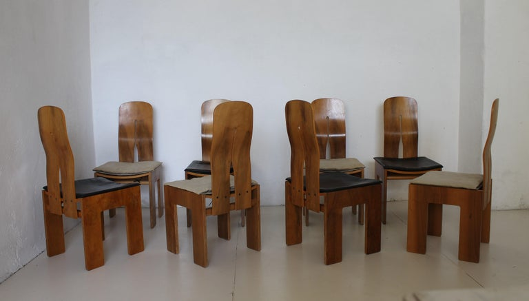 Eight Carlo Scarpa walnut chairs, black leather and canvas cushions mod. 1934 / 765 for Bernini 1977.  765 is planned by Carlo Scarpa in 1934, year from which the chair will take subsequently the name, but it will be produced only in the 1977.  The