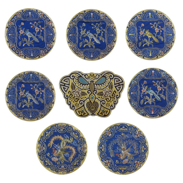 Eight Chinese Hand Embroidered Silk Blue Ground and Metallic Thread Mats For Sale