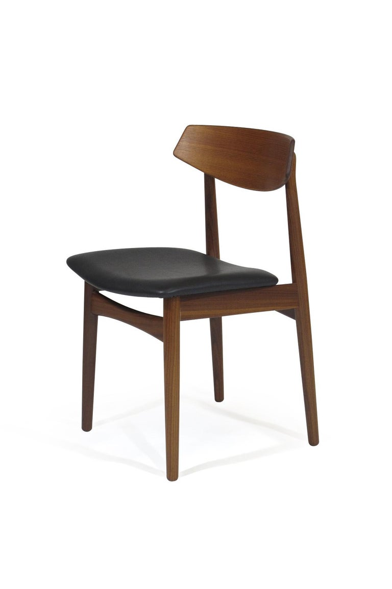 Scandinavian Modern Eight Danish Teak Dining Chairs For Sale