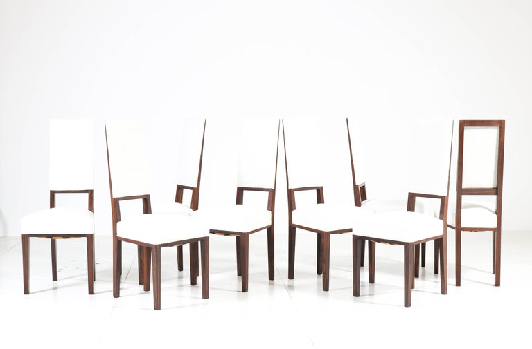 Wonderful and rare set of eight Art Deco dining room chairs. Design by 't Woonhuys Amsterdam. Striking Dutch design from the 1920s. Solid ebony Macassar and re-upholstered with cream white fabric. In very good original condition with minor wear