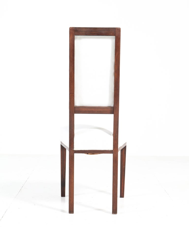 Early 20th Century Eight Ebony Macassar Art Deco Dining Room Chairs by 't Woonhuys Amsterdam, 1920s For Sale