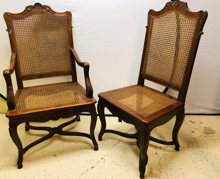 Set of eight French Country chairs with blind hand caning and hand carved very fine quality. This is a stunning and simply spectacular. These all hand caned and grooved dining chairs are in fine condition with a pair of arm and six side chairs all