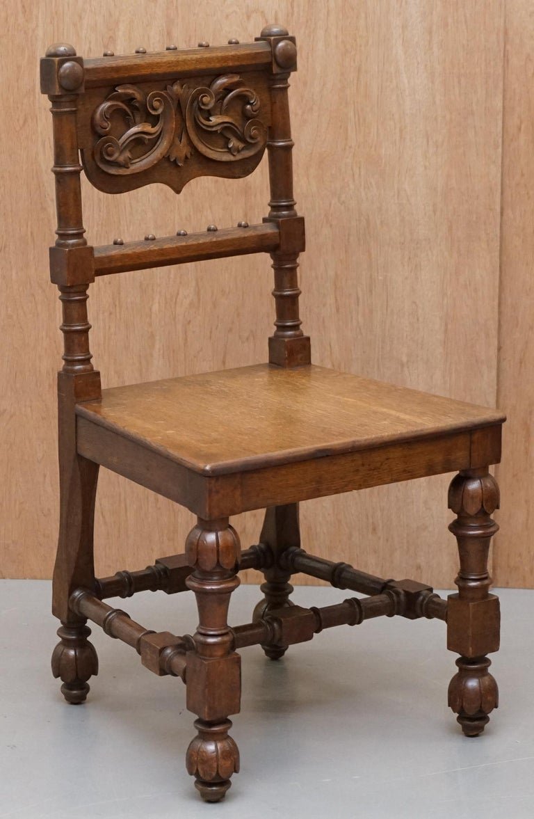 We are delighted to this lovely suite of eight Gothic Revival hand carved walnut dining chairs  A very good looking and well made suite, made in circa 1840 but based on a much earlier design, the frames are hand carved from solid slabs of walnut,
