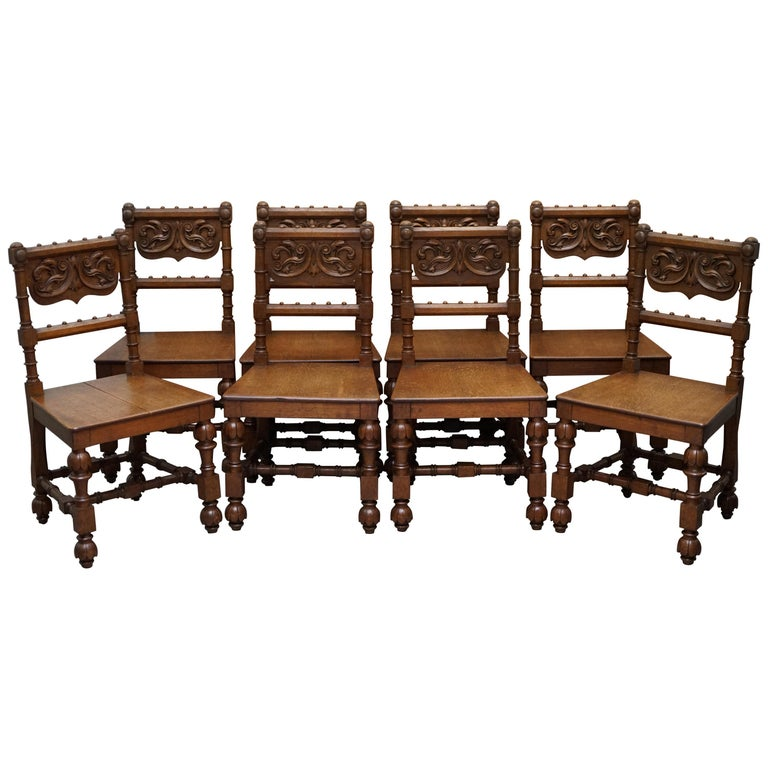 Eight Hand Carved Walnut Gothic Revival Dining Chairs circa 1840 Stunning Frames For Sale