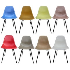 Eight Herman Miller Eames Multicolored Dining Chairs
