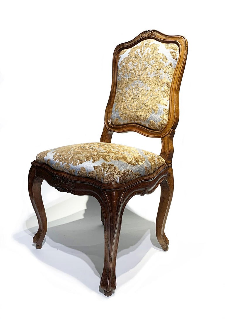 Eight walnut chairs, two with slight differences Genoa, mid-18th century Six chairs measure: height 98 cm - 46 cm at the seat x 58 cm x 50 cm (38.58