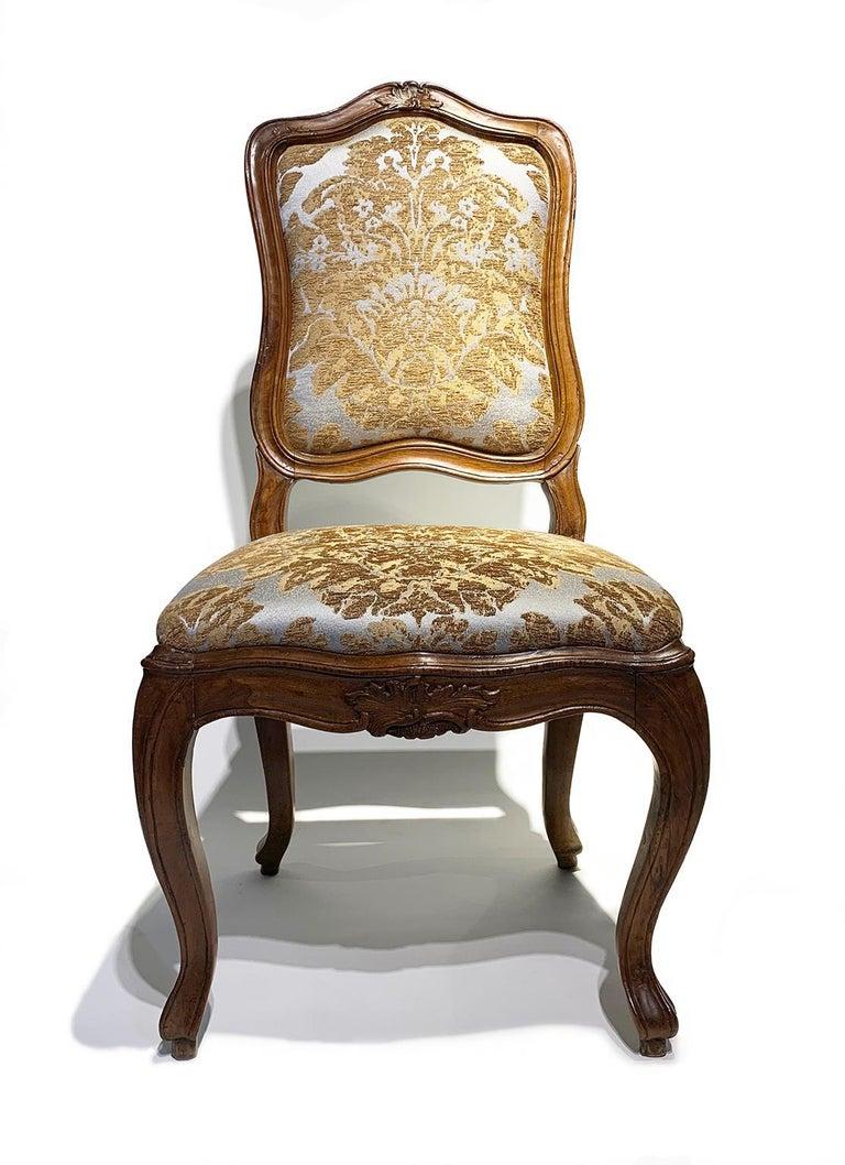 Rococo Eight Italian Chairs in Carved Walnut, Genoa, circa 1750 For Sale