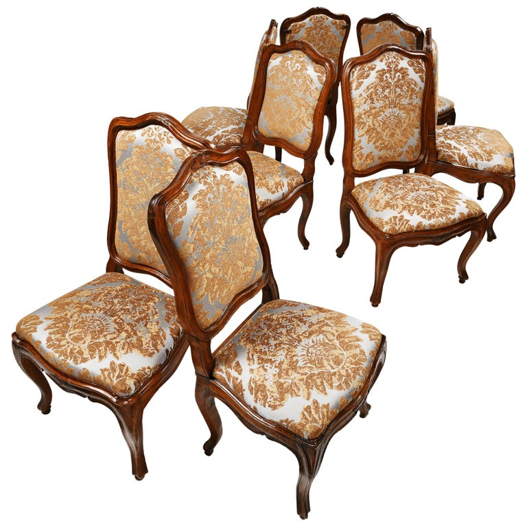 Eight Italian Chairs in Carved Walnut, Genoa, circa 1750 For Sale
