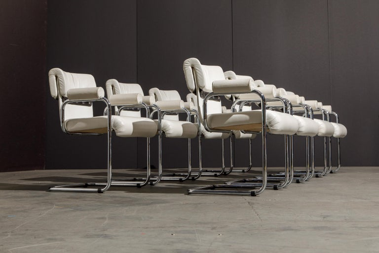 This handsome set of eight (8) armchairs were designed by Guido Faleschini for the Italian maker i4 Mariani, under The Pace Collection. The seats and backs retain the original supple white colored leather upholstery and are attached to graceful