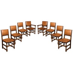Eight Leather Upholstered Oak Dining Chairs