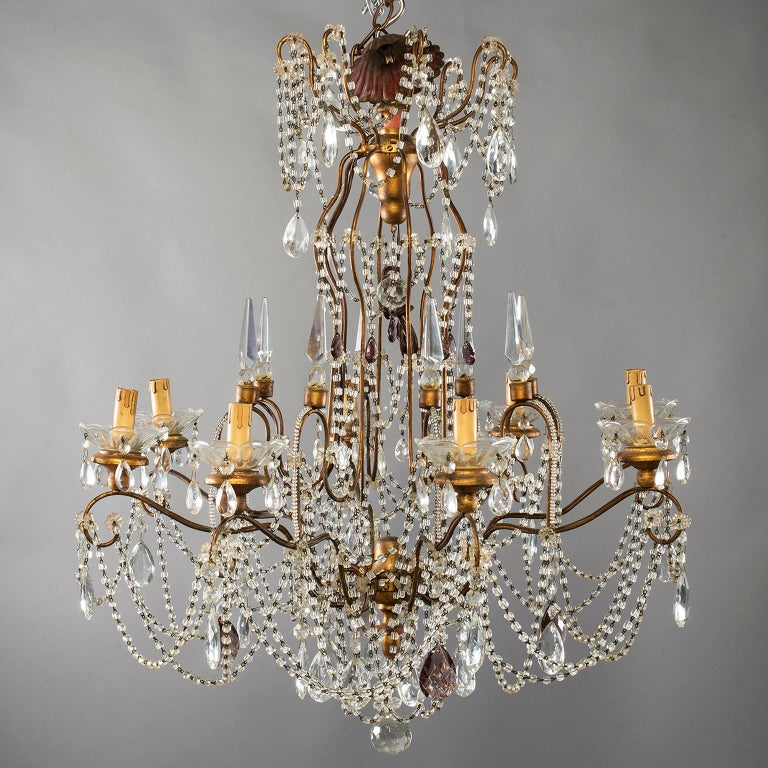 Eight-light Italian Crystal chandelier with giltwood Bobeches  large Italian crystal chandelier with brass frame, eight candle style lights, giltwood bobeches, large faceted crystal drops and crystal beading, circa 1920s. New wiring for US
