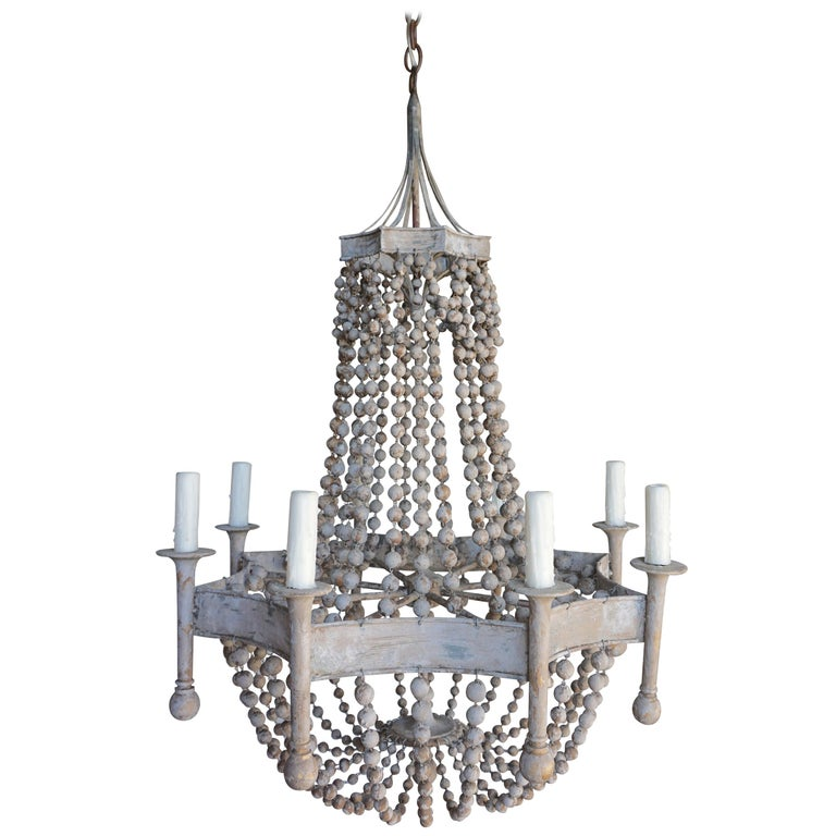 Eight Light Painted Wood Beaded Chandelier For Sale