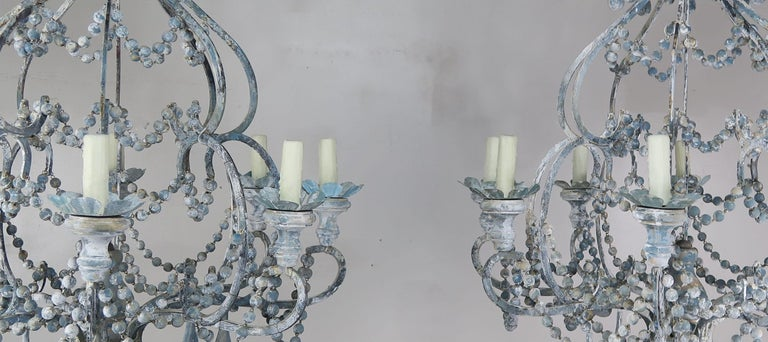 Rococo Eight-Light Wood Beaded Blue and Cream Painted Chandeliers, Pair For Sale