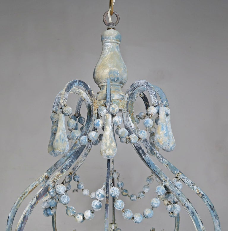 Eight-Light Wood Beaded Blue and Cream Painted Chandeliers, Pair In Distressed Condition For Sale In Los Angeles, CA