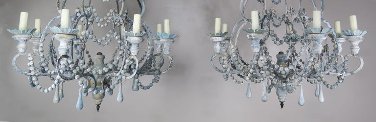 Contemporary Eight-Light Wood Beaded Blue and Cream Painted Chandeliers, Pair For Sale