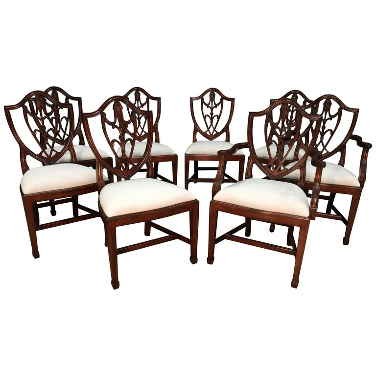 Eight Mahogany Shieldback Dining Chairs by Leighton Hall For Sale