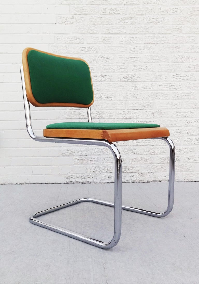 Vintage Marcel Breuer modern chairs made in Italy. Made from a single piece of bent tubular chrome-plated steel with a simple wood seat and back upholstery inserts in green. The cantilevered form gives the chair added flexibility and