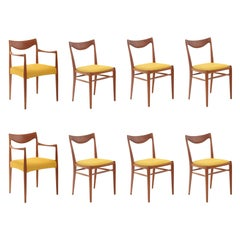 Eight Rastad and Relling Sculpted Teak Dining Chairs