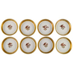 Eight Royal Copenhagen Golden Basket Coasters in Porcelain with Gold Edge