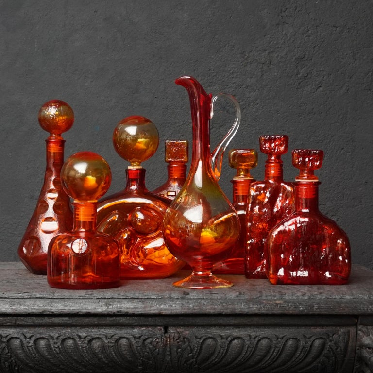 Very pretty set of eight 1960s Italian Empoli Rossini glass decanters in the ever-popular colour Tangerine Amberina, a mixture of ruby red and tangerine orange. In different shapes and styles. Some compare these colours to those of a brilliant