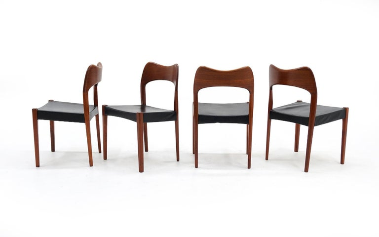 Danish Eight Teak with Black Leather Dining Chairs by Niels Otto Møller For Sale