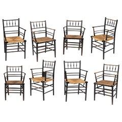 Eight William Morris Ebonized Sussex Armchairs