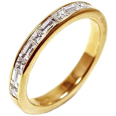 Eighteen Karat Gold Baguette Diamond Alternating Princess Diamond Partial Band