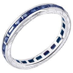 18 Karat Gold Baguette Sapphire Eternity Engraved Band Weighing 1.65 Carat