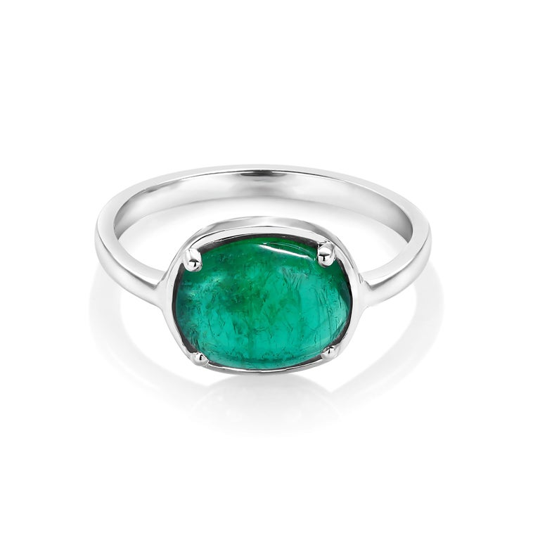 Eighteen karat white gold ring Cabochon emerald weighing 1.85 carat        Emerald measuring 9x7 millimeter                                                                 Ring size 6 In Stock Ring can be resized  New Ring Handmade in USA Our design