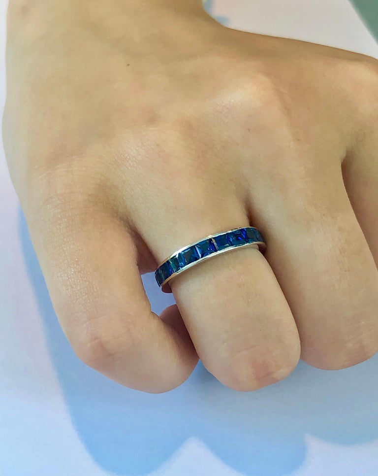 Eighteen karat white gold princess cut  sapphire eternity stacking or anniversary band  Princess cut sapphire weighing 4.60 carat  Ring measures 4 millimeter Made to order in special size Two-week delivery Rings are available in all sizes, half