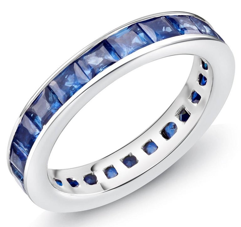 Contemporary 18 Karat Gold Princess Sapphire Eternity Band Ring Weighing 4.60 Carat For Sale