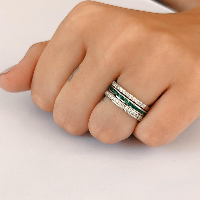 Eighteen karat white gold channel-set Tsavorite stacking or anniversary band  Tsavorite weighing 1.10 carat  New ring  Ring size 6.5 In Stock Handmade in USA Our team of graduate gemologists carefully hand-select every diamond and gemstone Our