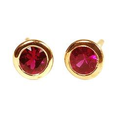 Eighteen Karat Yellow Gold Bezel Set Ruby Stud Earrings