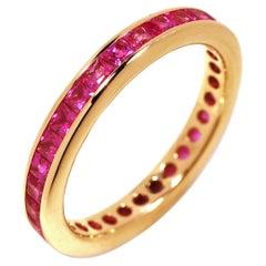 Eighteen Karat Yellow Gold Square Princess Cut Pink Sapphires Eternity Band