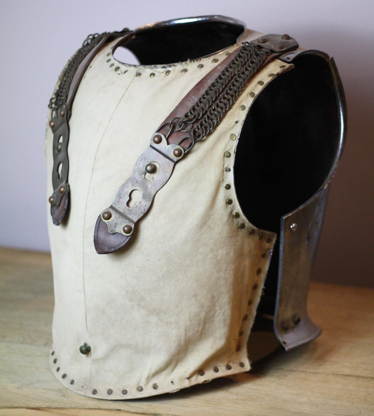 Rare and in good condition, 18th century British cavalry armour breastplate. Steel plate with cloth to the front. Two separate pieces with leather and metal hinged straps.