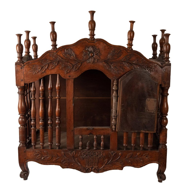 With wrought iron mounts and carved with sheaves of wheat, circa 1780.