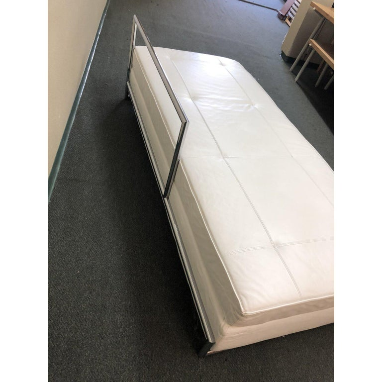 An Eileen Gray daybed. This beautiful piece is upholstered in white leather and the base is chromium plated steel tubing. Eileen Gray designed the daybed in 1925 and since then it is counted among the most famous products by her. Daybed is made by