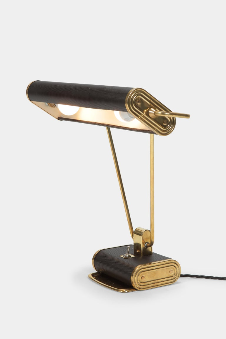 Eileen gray desk lamp, manufactured in France by the company Jumo in the 1940s. Shade and arm are swivel-mounted. The angle is adjustable. Completely restored, with new cable and new color applied in places. A piece of design history!
