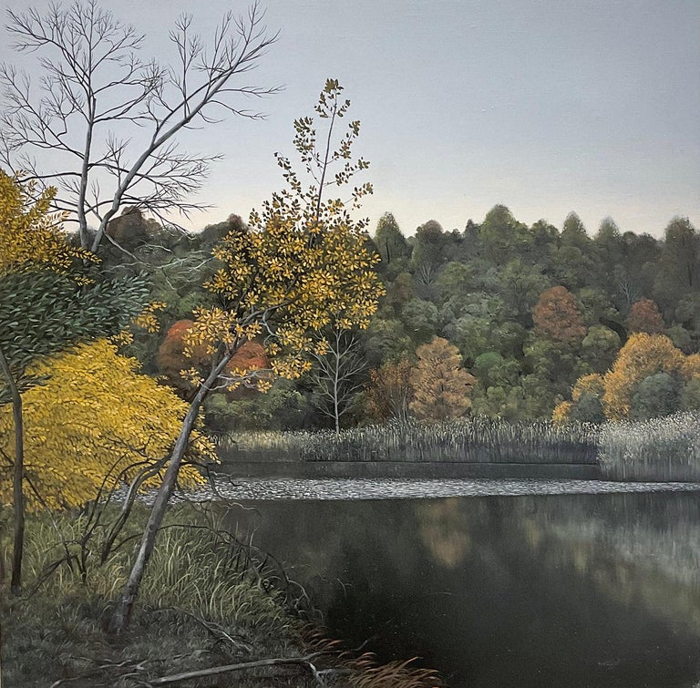 """Photo-realist fall foliage landscape painting of a calm pond in the Hudson River Valley under a grey-blue sky """"We Fall Into Indifferent Ponds"""", painted by Eileen Murphy in 2018 16 x 16 x 1 inches, oil on panel Signed verso   This contemporary,"""