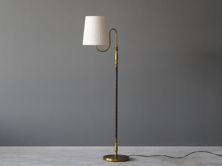 A rare adjustable floor lamp with an organic arm.