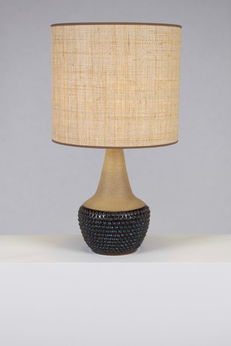 A blue & chestnut glazed table lamp with 'Teardrop' pattern, designed by Einar Johansen, manufactured by Söholm Stentöi, Bornhom, Denmark, 1960s. Excellent condition, rewired. Please note the lamp is sold without the Raffia Shade. Measures: Base