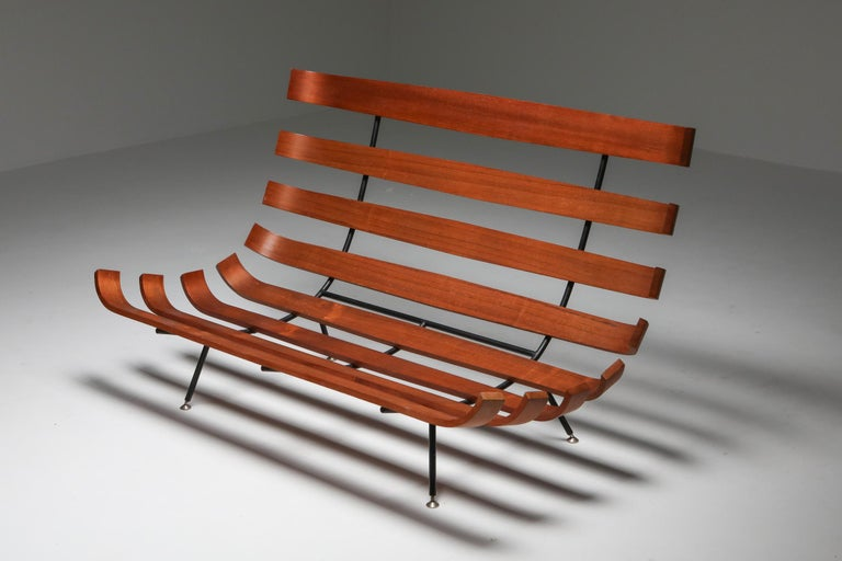 Martin Eisler & Carlo Hauner for Forma, sofa, Brazilian hardwood, metal, and fabric, Brazil, 1960s.  Pair of 'Bone' chairs by Brazilian designer duo Eisler and Hauner. This chair is iconic for Brazilian Mid-Century Modern design from the 1960s.