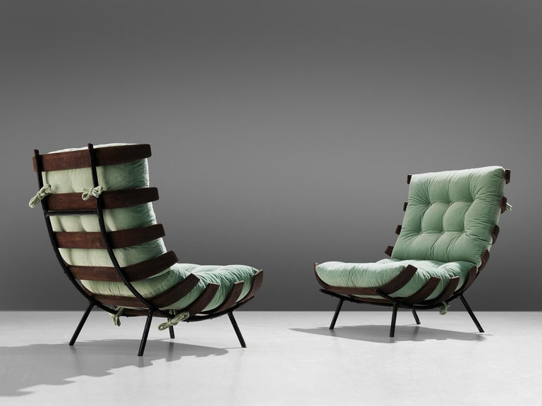 Martin Eisler & Carlo Hauner for Forma, pair of easy chairs, Brazilian hardwood, leather and metal, Brazil, 1960s.  Pair of'Bone' chairs by Brazilian designer duo Eisler and Hauner. This chair is iconic for Brazilian Mid-Century Modern, from the