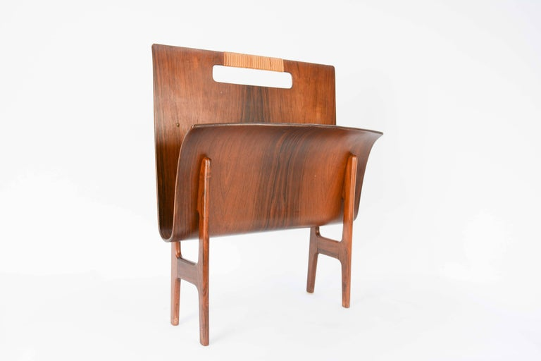 Ejnar Larsen & Axel Bender Madsen magazine stand in rosewood with a caned accented handle grip.