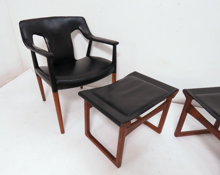 Danish teak lounge armchair and footstool/ottoman, circa mid-1950s. Designed by Ejner Larsen and Aksel Bender Madsen and made by Ludvig Pontoppidan. Note: each chair and ottoman set is priced separately (i.e., two sets available, each set consisting