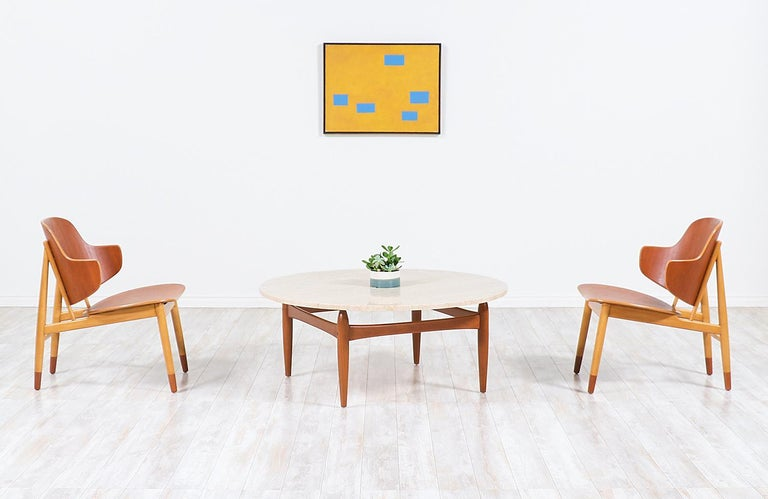 Beautiful Danish modern coffee table designed by Ejvind A. Johansson in collaboration with Danish company, Ludvig Pontoppidan from Denmark in the 1960s. Our elegant table features a solid structured teak wood base with uniquely sculpted tapered legs
