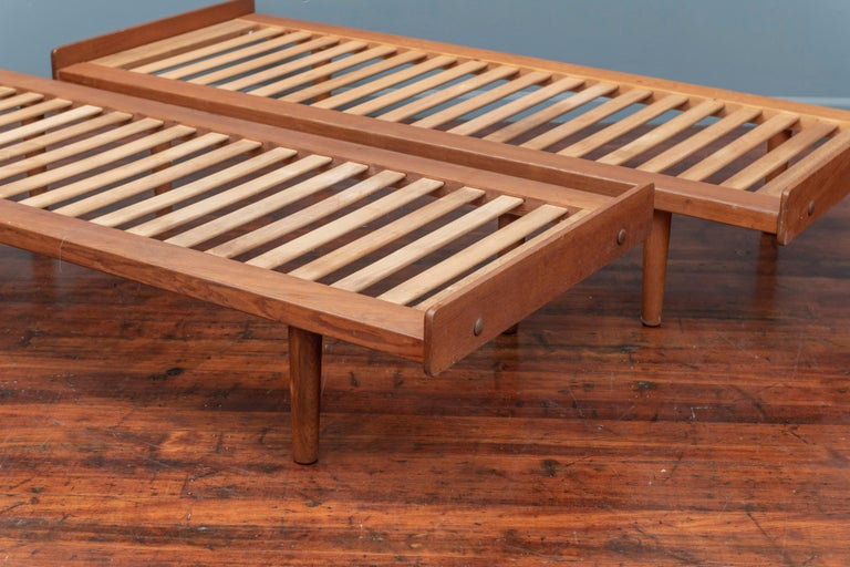 Pair of Ejvind Johansson design teak and oak daybeds, model G19 for FDB Mobler. Very good condition.