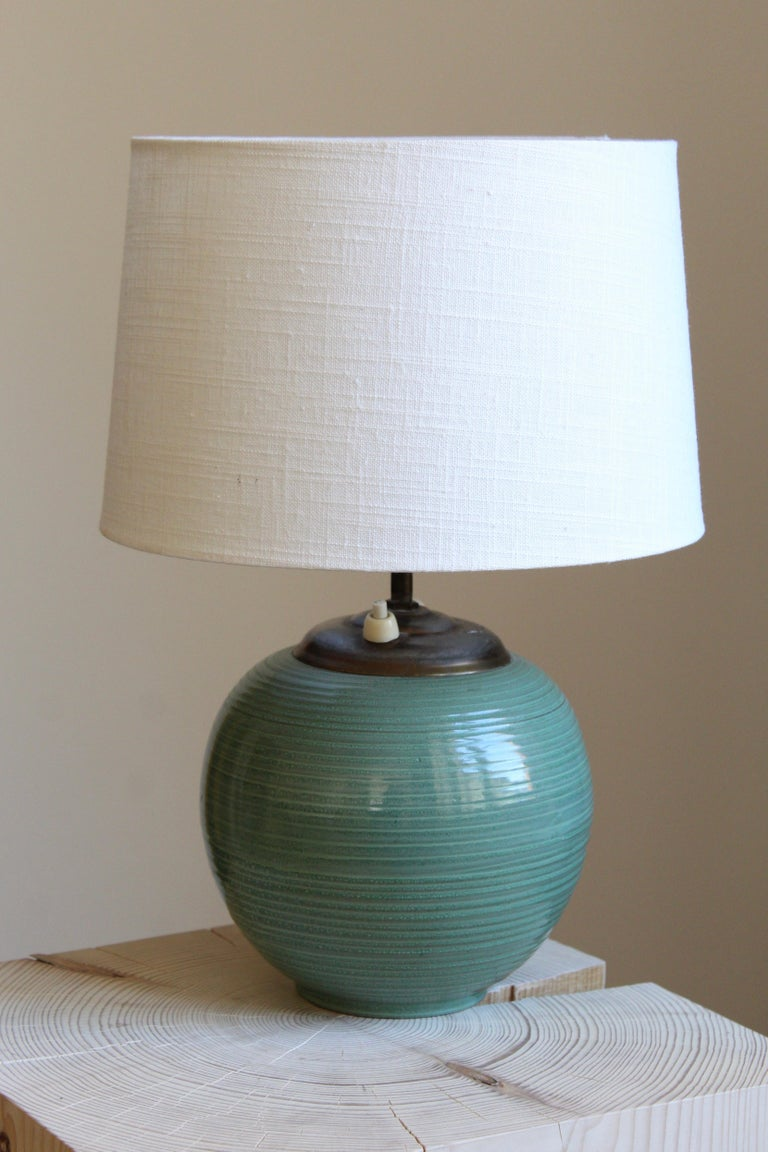 A table lamp by iconic Swedish ceramic firm Ekeby. In glazed stoneware. Marked. Brand new high-end linen lampshade.  Other designers of the period include Axel Salto, Carl Harry Stålhane, Berndt Friberg, Lisa Larsson, and Wilhelm Kåge.